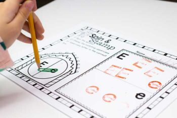 child spinning simple spinner for Christmas themed alphabet spin and stamp printable game