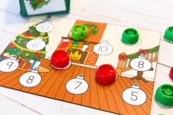 Red and green tokens used to cover numbers for a Christmas counting activity.