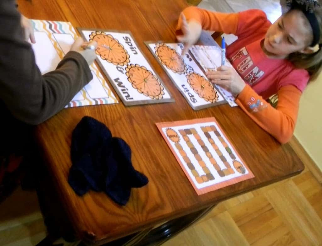 children playing printable board game for homeschool
