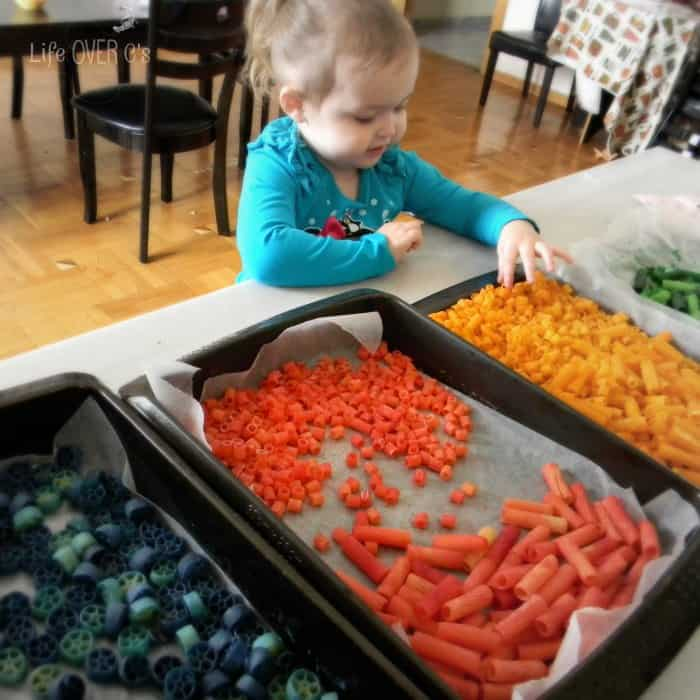 Dyeing pasta with vinegar is an easy way to add color to your pasta crafts and activities!