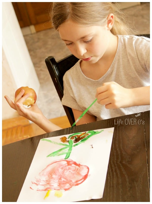 have an apple snack while painting