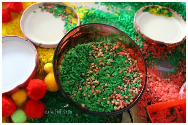apple sensory bin with rice