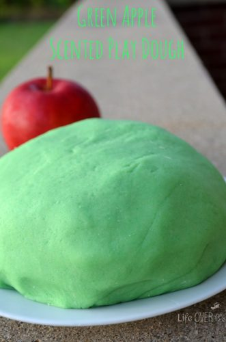 Vertical picture of green apple scented play dough ball