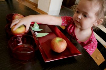 Putting apples in bowls while counting to three