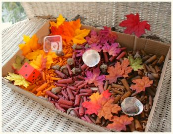 Fall sensory bin with acorns, leaves and pasta