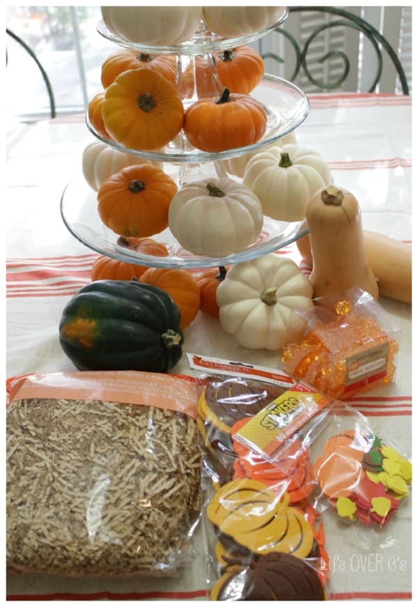 Supplies for creating a pumpkin patch sensory bin.