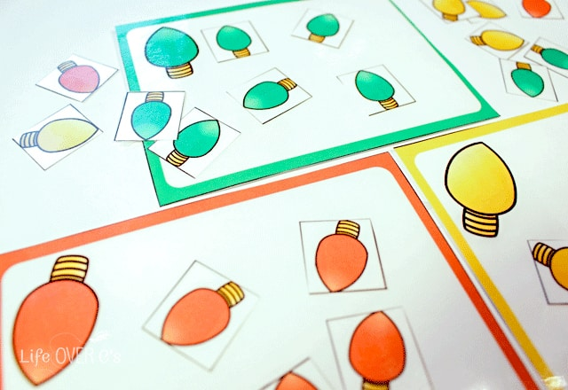 Practice sorting colors with your preschoolers with these fun Christmas lights in the preschool pack for Christmas.