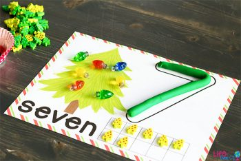 Christmas tree play dough counting mat with the number seven.
