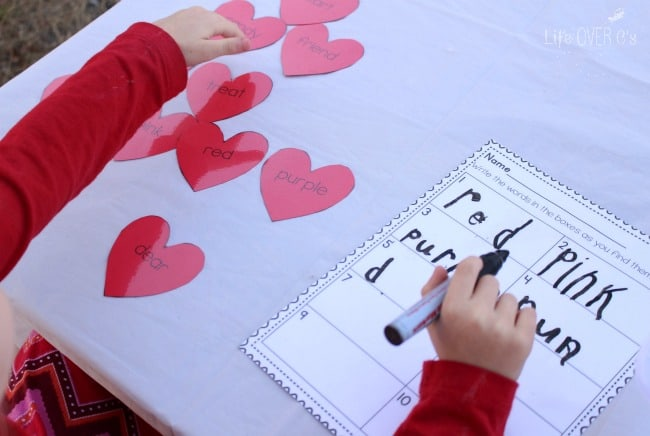 child writing words