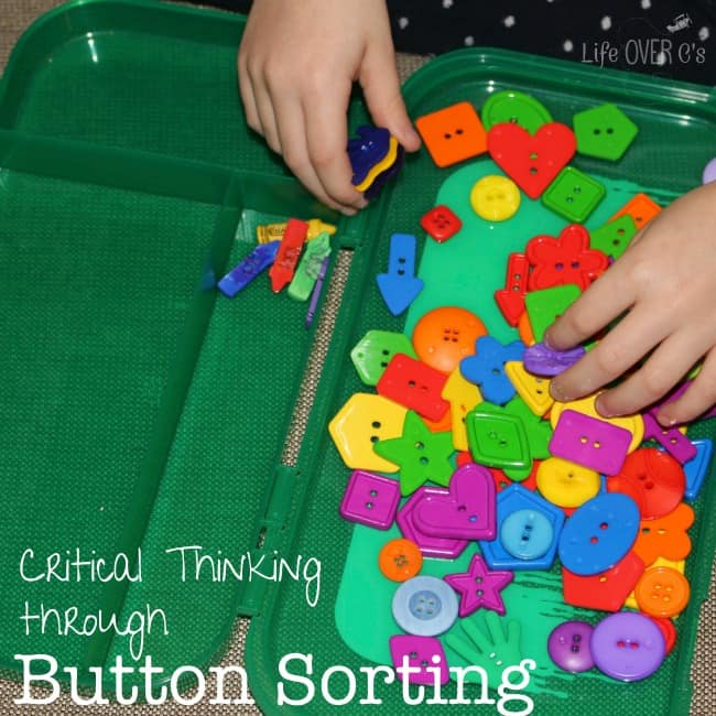 child sorting buttons