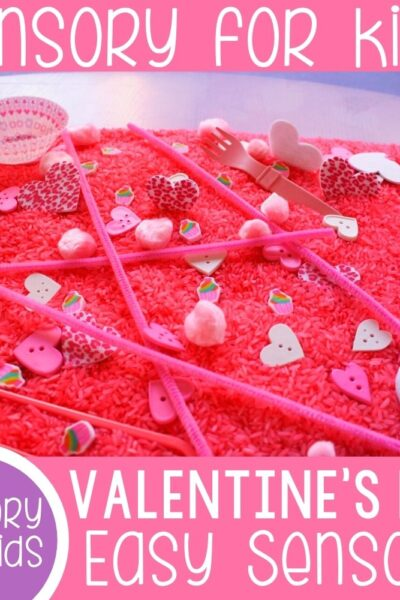 Valentine's Day Sensory bin with pink dyed rice using heart buttons and Valentines cupcake holders