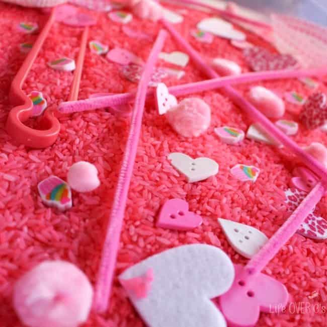 pink rice sensory bin