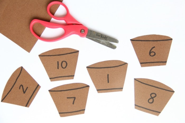 Create apple barrels for this hands-on apple fingerprint math activity.