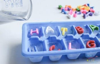 pouring water into letter cubes for slippery Ice word building activity for kids