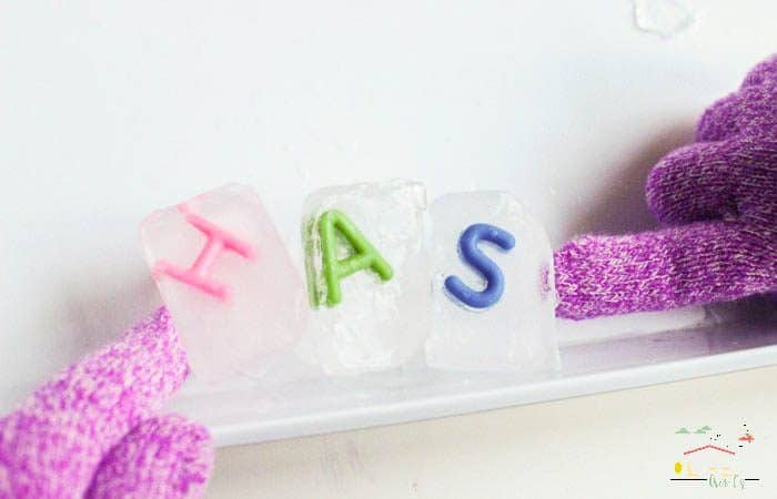 Making CVC words with ice cubes with slippery Ice word building activity for kids