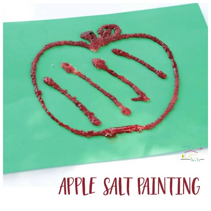 Kids will love this hands-on apple salt painting! It's a fun way to kick off the back-to-school season and FALL! Use this activity at school or home!