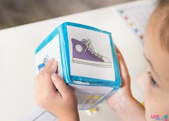 We love using our differentiated instruction cubes for math games! This fun colored shoe graphing activity for preschoolers is a fun math game!