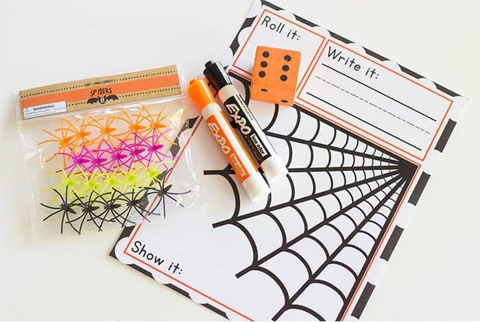 Free spider themed counting game for preschool. Roll and count math game for preschool. Roll a dice, write the number with a dry erase marker, and count it with mini erasers, fake spiders or another math manipulative.