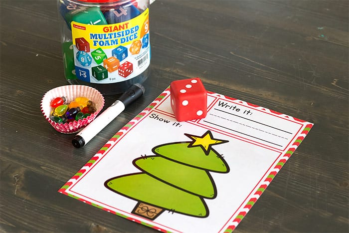 We love using our giant foam dice for math activities! They are so much fun to roll AND they are quieter than normal dice, so they don't disturb other learners. Use them on this free printable Christmas tree roll and count math activity for kindergarteners.