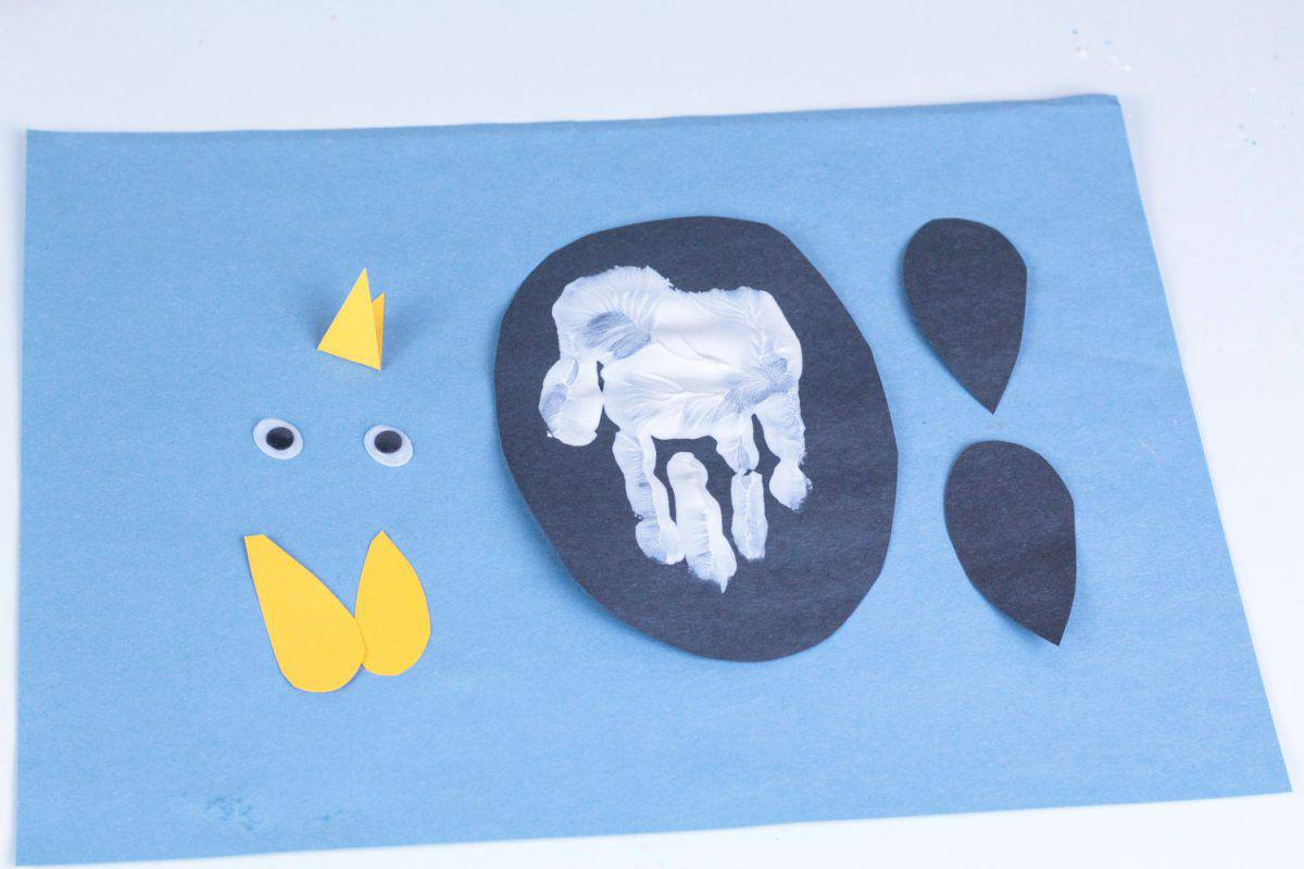 Gather all of the pieces needed to make a penguin hand print