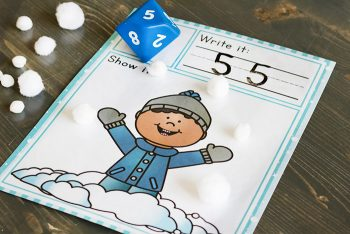 """The Snow Themed Roll and Count printable with the number """"5"""" written on it."""