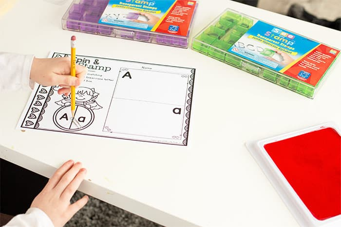 Preschool alphabet activity for stamping uppercase and lowercase letters.