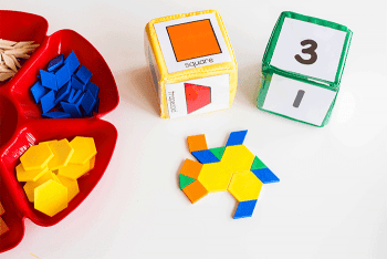 Build with pattern blocks and this free printable set of pattern block dice for math centers.