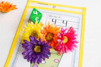 Free printable flower pot spring math game for kids. No prep dice game for math.
