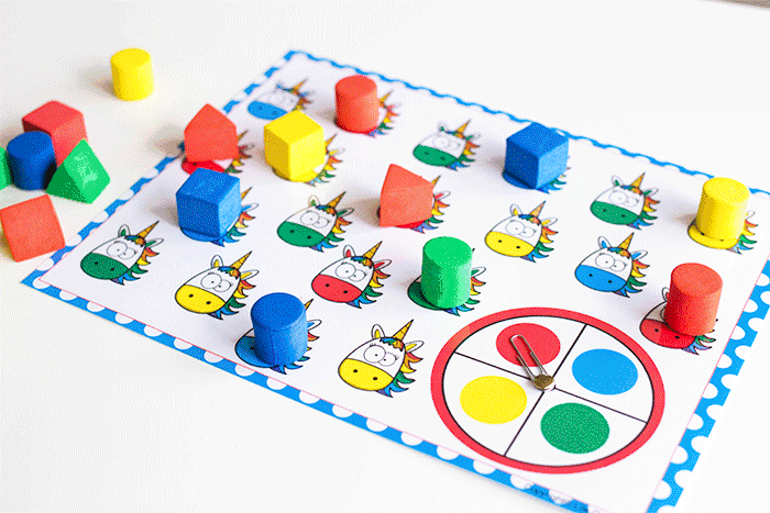 Unicorn color matching board game for preschoolers. Spinner with red, yellow, blue and green colors.