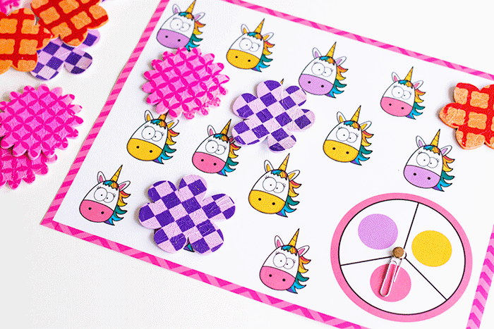 Unicorn themed spinner game for preschoolers. Match colors pink, purple and orange.
