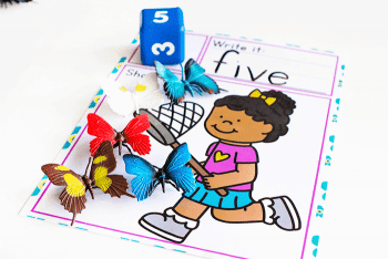 Use dice to work on number identification with this free printable kindergarten math game for spring.