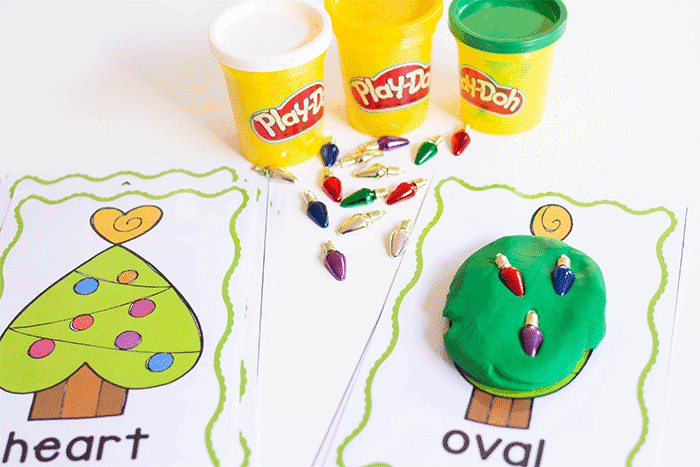 Use Play Doh to create shapes on these free Christmas play dough mats for preschool.