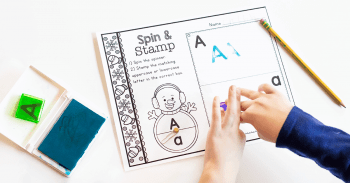 """A child completing the Snowman Spin & Stamp Alphabet Activity worksheet for the letter """"A""""."""