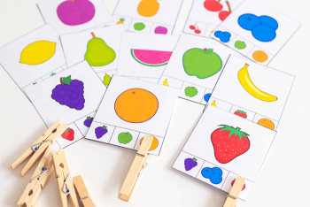 Fruit clip cards for matching fruit pictures. Place the clothespin on the matching pictures at the bottom of each card.