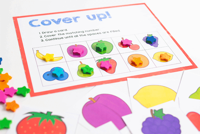 Free printable fruit grid game for matching fruit pictures with preschoolers.