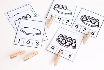 Free printable winter math activities for preschoolers. Practice fine motor skills with these math clip cards for matching and counting to 10.