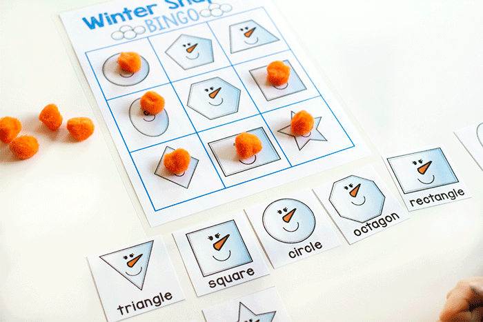 Free printable kindergarten shapes activity. Play winter BINGO with this adorable 2D shape snowmen.