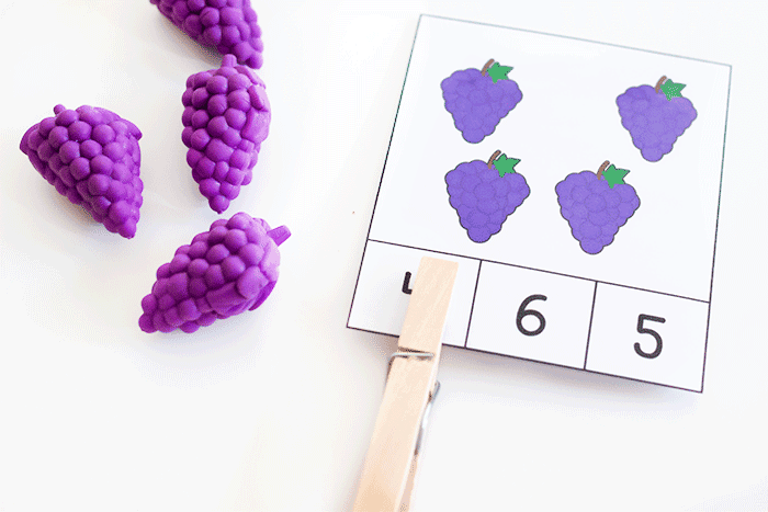 Free printable fruit themed clip cards for preschool counting activities.