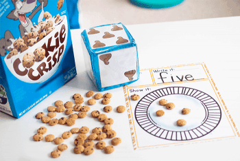 Build number recognition with this chocolate chip roll and count dice game for preschoolers.