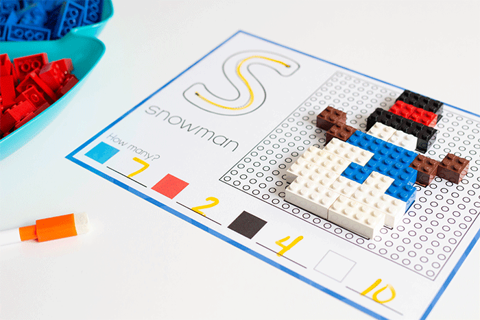 Build a snowman with LEGO bricks using these winter fine motor activities for LEGO bricks.