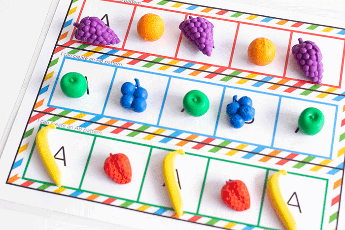 Create an AB pattern with guidance using this fruit themed pattern mat set for kindergarten math centers.