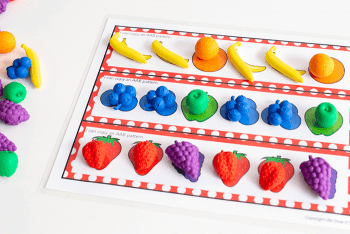 Copy an AAB pattern with fruit math counters. Kindergarten math center for patterns.