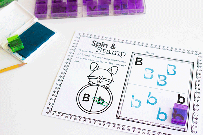 Use letter stamps with this fun spring letter recognition printable for preschool literacy centers. Spin the spinner and stamp the correct uppercase or lowercase letter