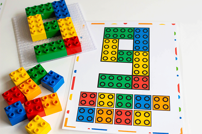 Use DUPLO blocks for counting with these free printable LEGO DUPLO counting number mats for a preschool math activity