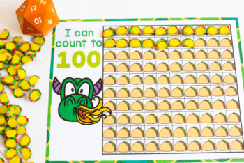 Count to 100 counting game for preschool. Use a 20-sided die and cover the spaces on the Dragon and Taco themed counting grid with taco mini erasers.