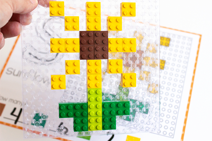 LEGO sunflower on a clear baseplate with a free printable fall fine motor activity for preschoolers.