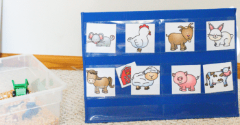 Free printable farm animal game for preschoolers. Pocket chart with farm animal pictures and a barn picture hidden behind a sheep for preschoolers to guess the name of the animal.