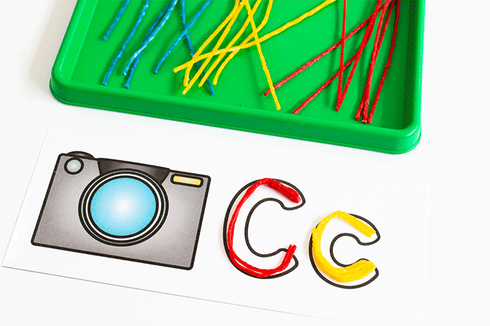 Use Wikki Stix to create cletters of the alphabet on alphabet outline mats for preschool literacy centers.