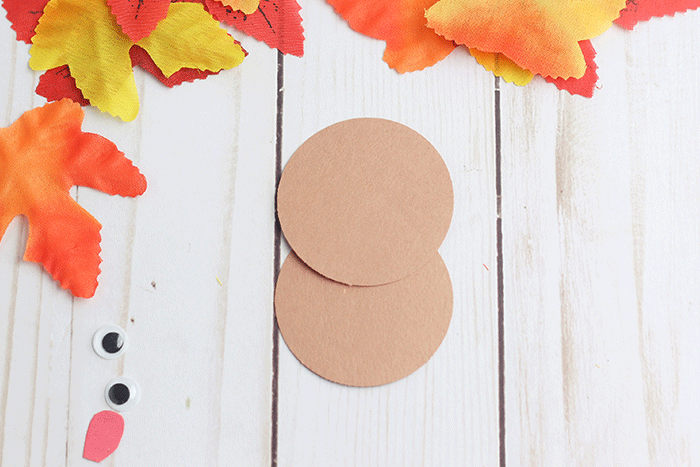 Create a thanksgiving turkey craft for preschool with construction paper and fake fall leaves