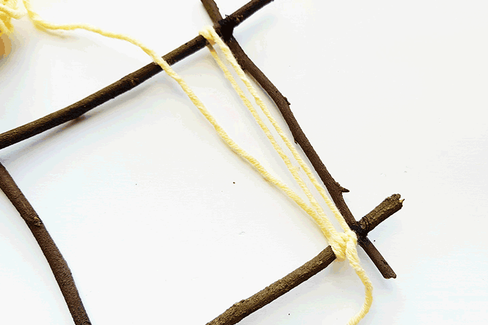 Create your own weaving loom for kids with some sticks and your yarn stash. An easy fine motor craft for kids